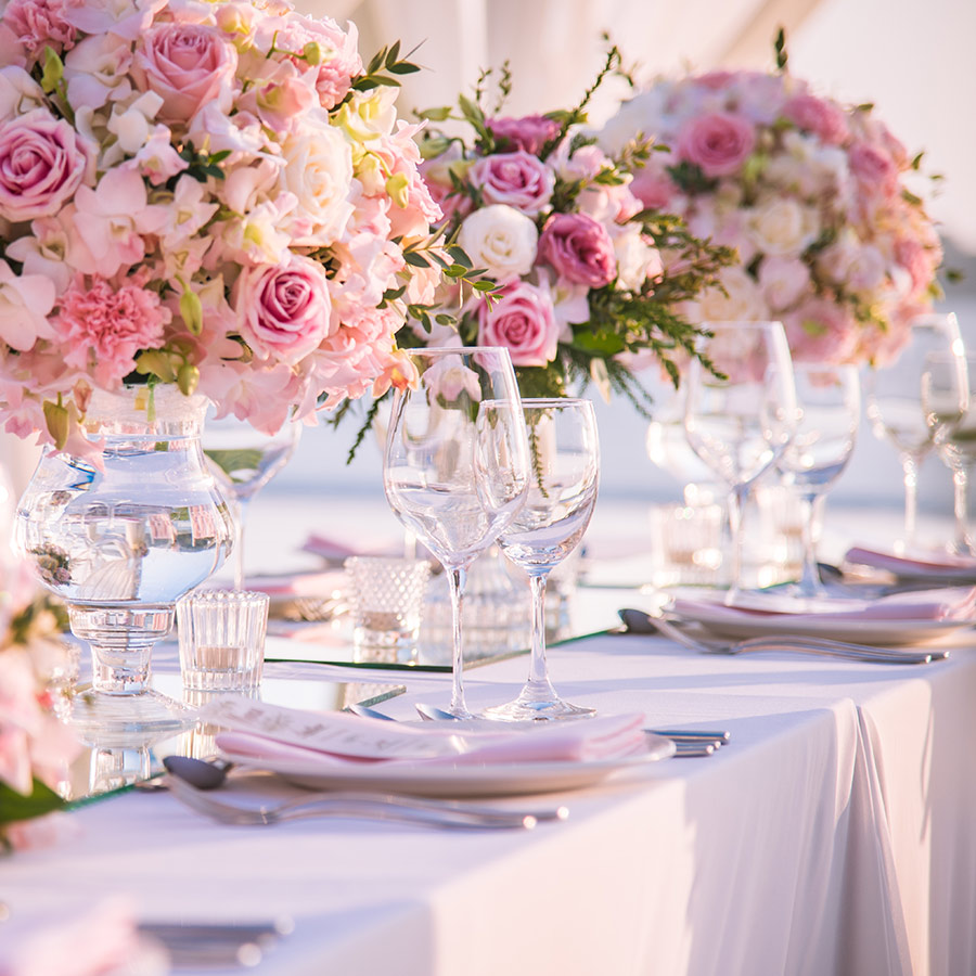 Table setting at aluxury wedding and Beautiful flowers on the table.